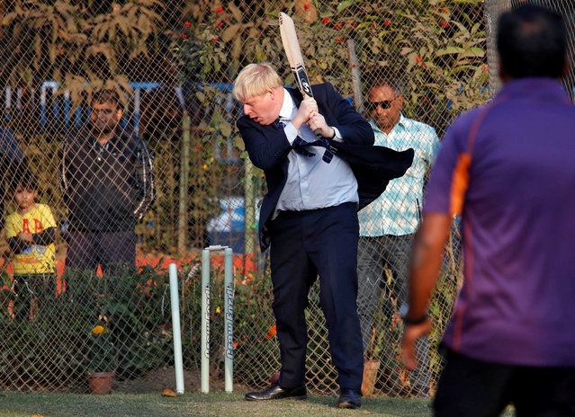 British foreign secretary, Boris Johnson, looks at the stumps as he is bowled during his visit to a cricket academy in Kolkata, India, January 19, 2017. (Photo by Rupak De Chowdhuri/Reuters)