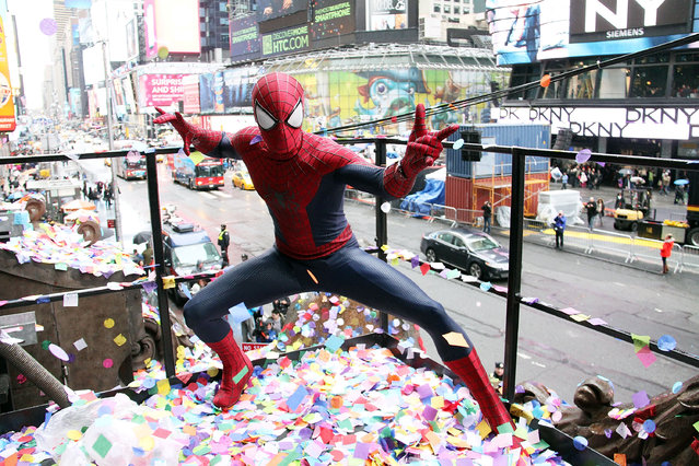 A person dressed as Spiderman attends the 2014 New Year's Eve Confetti Test at Hard Rock Cafe, Times Square on December 29, 2013 in New York City. (Photo by Laura Cavanaugh/FilmMagic)