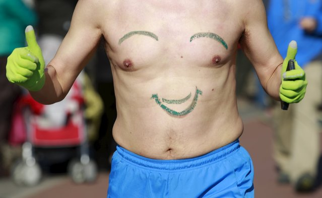 "A participant gestures while running in the ""Half-Naked Marathon"" at Olympic Forest park in Beijing, China, February 28, 2016 (Photo by Kim Kyung-Hoon/Reuters)"