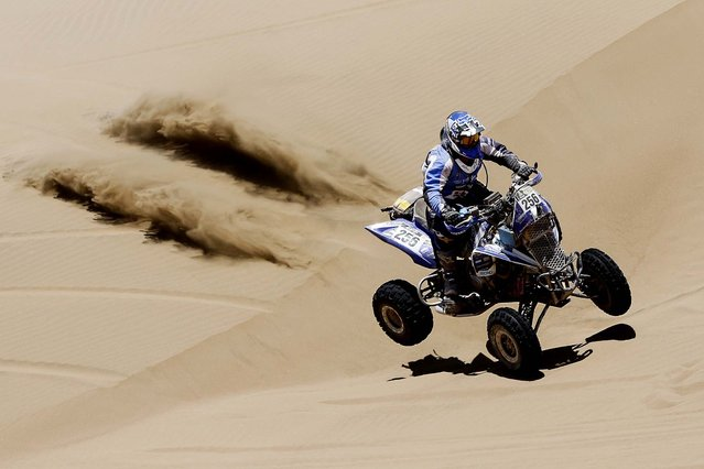 Yamaha rider Sergio Lafuente of Uruguay races across the dunes during the ninth stage of the Dakar Rally. (Photo by Victor R. Caivano/Associated Press)