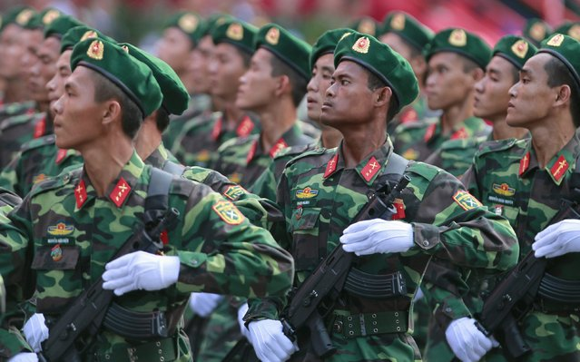 Vietnamese soldiers of border guard force march during a rehearsal for a military parade as part of the 40th anniversary of the fall of Saigon in southern Ho Chi Minh City (formerly Saigon City), Vietnam, on April 26, 2015. (Photo by Reuters/Kham)