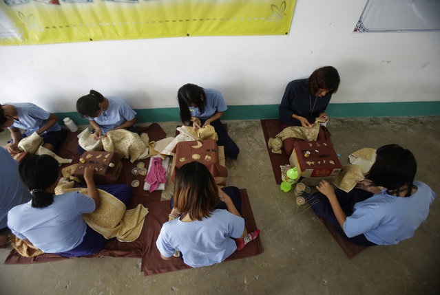 In this January 6, 2017 photo, transgender inmates learn embroidery at Pattaya Remand Prison in Pattaya, Chonburi province, Thailand. (Photo by Sakchai Lalit/AP Photo)