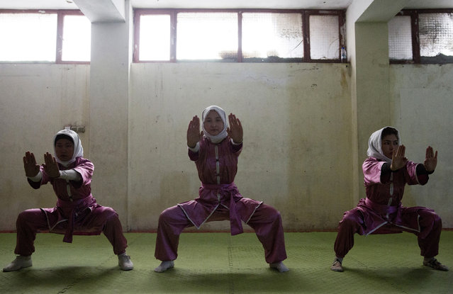 Shaolin martial arts students train at their club in Kabul, Afghanistan, Tuesday, January 25, 2017. Most of the students are teenagers, while a few of the older students study in universities. The head trainer, Azimi charges between $2 and $5 a month depending on what they can afford. (Photo by Massoud Hossaini/AP Photos)