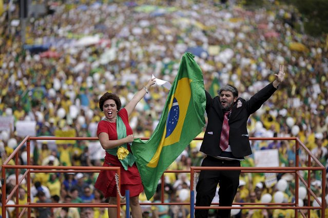 Demonstrators depicting Brazil's former President Luiz Inacio Lula da Silva (R) and Brazil's President Dilma Rousseff attend a protest against Rousseff, part of nationwide protests calling for her impeachment, in Brasilia, Brazil, March 13, 2016. (Photo by Ueslei Marcelino/Reuters)