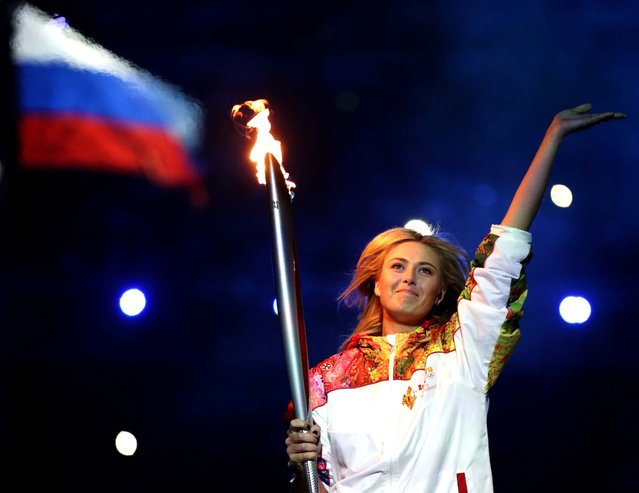 Russia's Maria Sharapova carries the torch during the opening ceremony of the 2014 Winter Olympics in Sochi, Russia, Friday, February 7, 2014. (Photo by Matt Dunham/Associated Press)