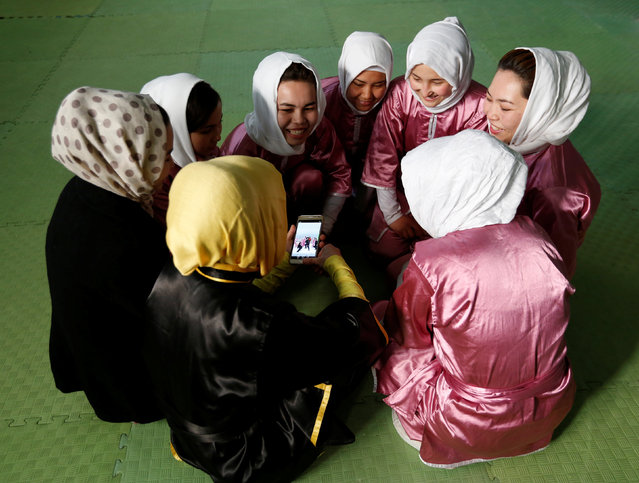 Students of the Shaolin Wushu club chat before an exercise in Kabul, Afghanistan January 19, 2017. (Photo by Mohammad Ismail/Reuters)