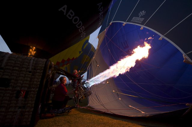 A hot air balloon is prepared for flight on the 30th anniversary of the Canberra Balloon Festival in Australia's capital, March 14, 2016. (Photo by Lukas Coch/Reuters/AAP)