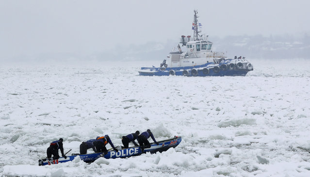 Team Police de Quebec compete during the Ice Canoe race at the Quebec Winter Carnival in Quebec City, February 5, 2017. (Photo by Mathieu Belanger/Reuters)