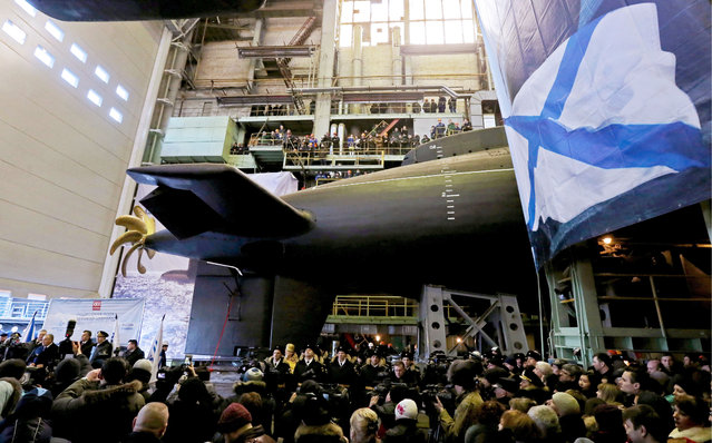 People attend the launch ceremony for the Veliky Novgorod, a Varshavyanka-class submarine (Project 636), at the Admiralteyskie Verfi shipyard in St Petersburg, Russia on March 18, 2016. These attack submarines are mainly intended for anti-shipping and anti-submarine operations in relatively shallow waters. Project 636 boats are equipped with improved MGK-400EM, with MG-519 Afra also upgraded to MG-519EM. The improved sonar systems have reduced the number of operators needed by sharing the same console via automation. (Photo by Alexander Demianchuk/TASS)