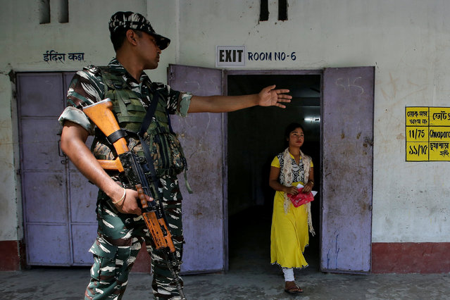 A woman leaves after casting her vote at a polling station during the first phase of general election in Alipurduar district, in the eastern state of West Bengal, India, April 11, 2019. (Photo by Rupak De Chowdhuri/Reuters)