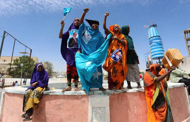 Somali women sing as they celebrate the election of President Mohamed Abdullahi Mohamed in the streets of Somalia's capital Mogadishu, February 9, 2017. (Photo by Feisal Omar/Reuters)