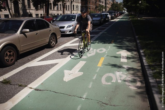 A man rides his bike along a controversial bike lane on Prospect Park West