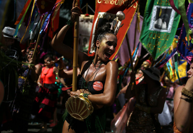 Revellers take part in the annual block party Cordao de Boitata during pre-carnival festivities in Rio Janeiro, Brazil February 19, 2017. (Photo by Pilar Olivares/Reuters)