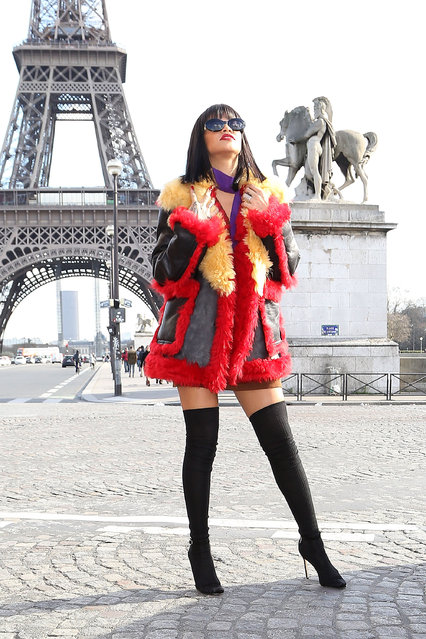 Singer Rihanna poses in front of the Eiffel tower on March 5, 2014 in Paris, France. (Photo by Marc Piasecki/GC Images)