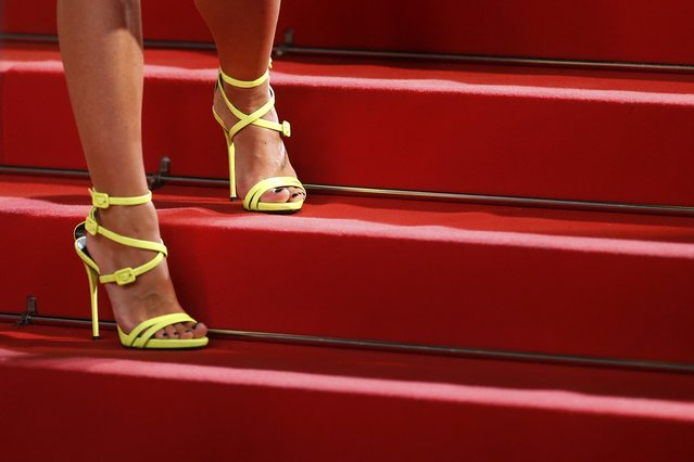 "The shoes of an unidentified guest are pictured as she pose on the red carpet for the screening of the film ""The Lobster"" in competition during the 68th Cannes Film Festival in Cannes, southern France, May 15, 2015. (Photo by Benoit Tessier/Reuters)"