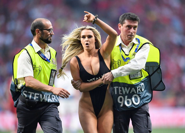 Pitch invader Kinsey Wolanski  is taken away by security during the Champions League final soccer match between Tottenham Hotspur and Liverpool at the Wanda Metropolitano Stadium in Madrid, Saturday, June 1, 2019. (Photo by Toby Melville/Reuters)