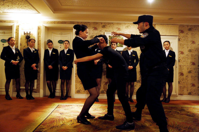 Hotel staff attend a self-defence skills training given by Special Weapons and Tactics (SWAT) team, in Hangzhou, Zhejiang province, April 7, 2016. (Photo by Reuters/Stringer)
