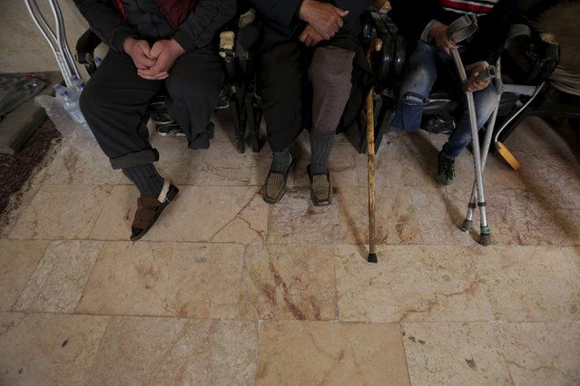 Men with amputated limbs wait to be inspected in the rebel-controlled area of Maaret al-Numan town in Idlib province, Syria March 20, 2016. (Photo by Khalil Ashawi/Reuters)