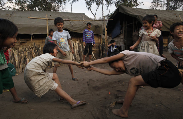 Children play in a refugee camps in Laiza, an area controlled by the Kachin, northern Myanmar, Sunday, February 12, 2012. (Photo by Vincent Yu/AP Photo)