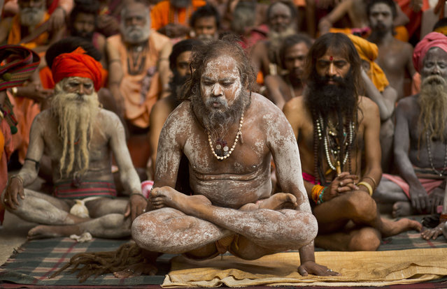 Indian Sadhus, or Hindu holy men, perform yoga to mark International Yoga Day at Kamakhya temple in Gauhati, India, Friday, June 21, 2019. (Photo by Anupam Nath/AP Photo)
