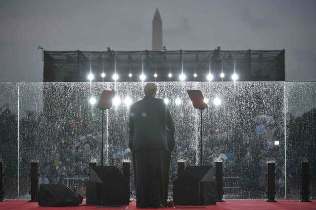 "US President Donald Trump speaks during the ""Salute to America"" Fourth of July event at the Lincoln Memorial in Washington, DC, July 4, 2019. (Photo by Mandel Ngan/AFP Photo)"