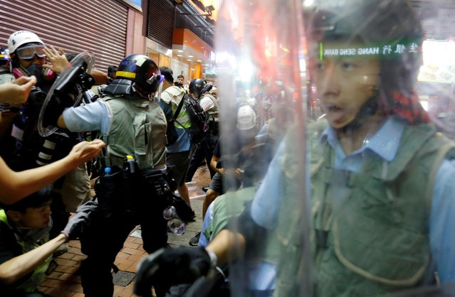 Riot police officers try to disperse anti-extradition bill protesters during a demonstration in Mong Kok area in Hong Kong, China, July 7, 2019. Tens of thousands of anti-government protesters rallied outside a controversial train station linking the territory to the Chinese mainland on July 7, the latest mass show of anger as activists try to keep pressure on the city's pro-Beijing leaders. (Photo by Thomas Peter/Reuters)