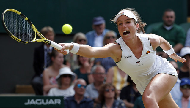 Britain's Johanna Konta returns to Czech Republic's Petra Kvitova in a Women's singles match during day seven of the Wimbledon Tennis Championships in London, Monday, July 8, 2019. (Photo by Alastair Grant/AP Photo)
