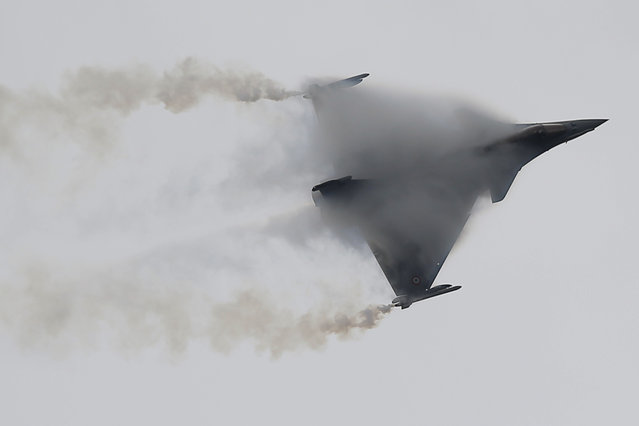 "French Capt. Benoit Planche, nicknamed ""Tao"", performs with a Rafale single seat jet aircraft during a demonstration flight at the Paris Air Show, in Le Bourget airport, north of Paris, Thursday, June 18, 2015. Some 300,000 aviation professionals and spectators are expected at this weekends Paris Air Show, coming from around the world to make business deals and see dramatic displays of aeronautic prowess and the latest air and space technology. (AP Photo/Francois Mori)"