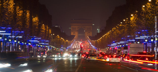 Christmas illuminations are lit along the Champs Elysees avenue  on November 23, 2011 in Paris, France