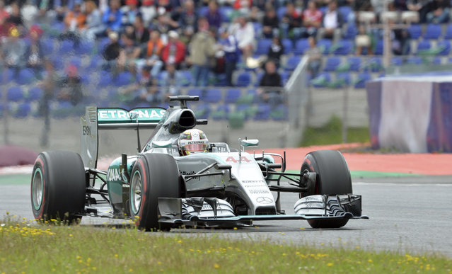 Mercedes driver Nico Rosberg of Germany steers his car during the Austrian Formula One Grand Prix race at the Red Bull Ring  in Spielberg, southern Austria, Sunday, June 21, 2015. (AP Photo/Kerstin Joensson)