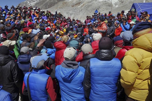 This April 24, 2014 photo released by Adrian Ballinger, founder and head guide of Alpenglow Expeditions, shows a meeting between Nepalese government delegation and Sherpa mountain guides near Everest base camp, Nepal. (Photo by Adrian Ballinger/AP Photo/Alpenglow Expeditions)