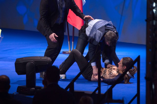 Security guards remove the Femen protestor who attempted to storm the stage during french presidential far-right candidate Marine Le Pen speech during a campaign rally at Zenith on April 17, 2017 in Paris, France. (Photo by Laurent Chamussy/SIPA Press/Rex Features/Shutterstock)