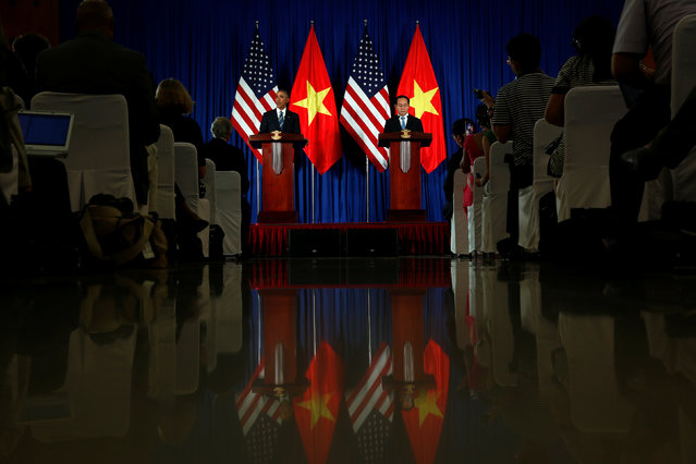U.S. President Barack Obama attends a news conference with Vietnam's President Tran Dai Quang at the Presidential Palace Compound in Hanoi, Vietnam, May 23, 2016. (Photo by Carlos Barria/Reuters)