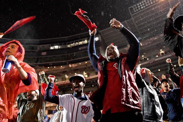 Washington Nationals fans celebrate at the Watch Party for Game 7 of the World Series against the Houston Astros at Nationals Park, in Washington, D.C. on October 30, 2019. (Photo by Katherine Frey/The Washington Post)