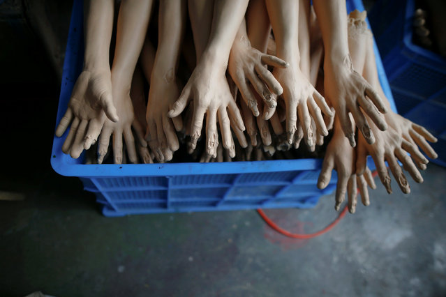 A box is filled with parts of dolls at Jinhua Partytime Latex Art and Crafts Factory in Jinhua, Zhejiang Province, China, May 25, 2016. (Photo by Aly Song/Reuters)