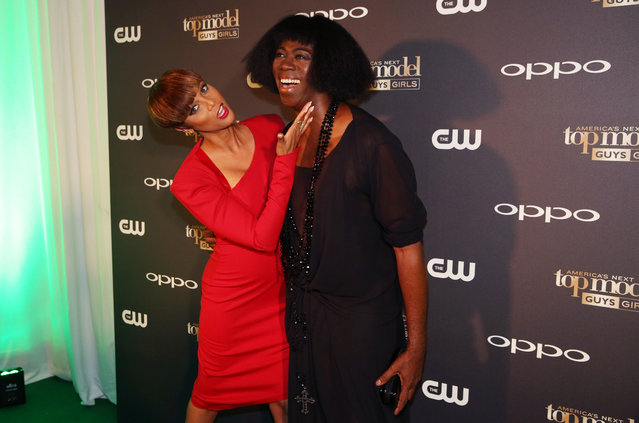 Tyra Banks, left, and J. Alexander pose together at the America's Next Top Model Cycle 22 premiere party in Los Angeles on Tuesday, July 28, 2015.  OPPO, a leading global smartphone brand, is featured throughout ANTM's cycle 22 set to air August 5 on the CW network. (Photo by Matt Sayles/Invision for OPPO/AP Images)