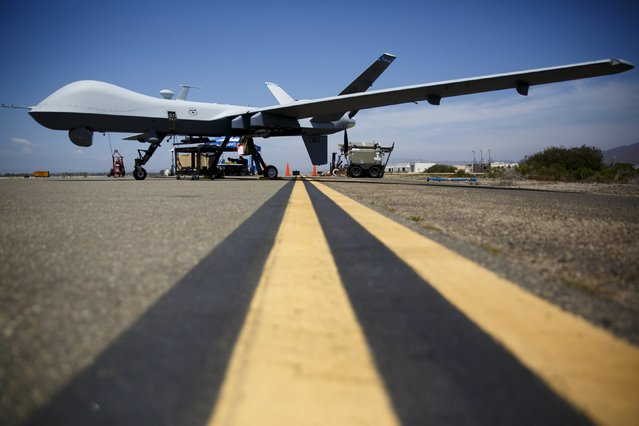 "A General Atomics MQ-9 Reaper stands on the runway during ""Black Dart"", a live-fly, live fire demonstration of 55 unmanned aerial vehicles, or drones, at Naval Base Ventura County Sea Range, Point Mugu, near Oxnard, California July 31, 2015. (Photo by Patrick T. Fallon/Reuters)"