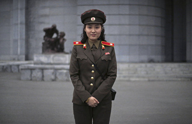 """In this April 9, 2017, photo, Capt. Ri Ok Gyong, 24, poses for a portrait at the Fatherland Liberation Museum in Pyongyang, North Korea. Ri has been a guide at the museum for two years. She studied at Pyongyang University of Foreign Language, where she learnt to speak English and Chinese. She enjoys her job because she wants to help foreigners understand the """"real history of the Korean War, and the United State's false propaganda about North Korea"""". Her motto: """"I want to serve in the army forever, uplifting the Songun idea (military first) of Kim Il Sung"""". (Photo by Wong Maye-E/AP Photo)"""