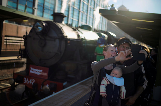 """A family takes a """"selfie"""" in front of restored steam locomotive 3642 before leaving Sydney's Central Railway Station, June 11, 2016 on an excursion celebrating Australia's transport heritage. (Photo by Jason Reed/Reuters)"""