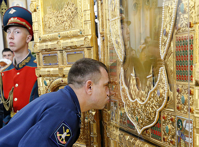 A serviceman kisses the main icon for the Russian Armed Forces' main cathedral, delivered at the Church of Our Lady the Healer in Rostov-On-Don, Russia in May 15, 2018. The Russian Armed Forces' main cathedral is to be built in Patriot Military Park in Kubinka outside Moscow by 2020, the year of the 75th anniversary of the victory of the Soviet Red Army over Nazi Germany in the 1941-45 Great Patriotic War, the Eastern Front of World War II. (Photo by Valery Matytsin/TASS)