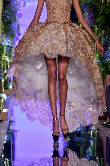 A model presents a creation of the Fall/Winter 2017/18 Haute Couture collection by Chinese designer Guo Pei during the Paris Fashion Week, in Paris, France, 02 July 2017. (Photo by Christophe Petit Tesson/EPA/EFE)