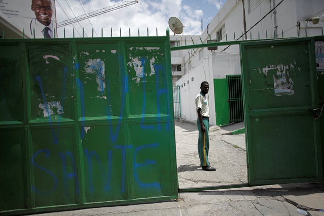 A security guard stands at the entrance of the Hospital of the State University of Haiti, which is one of the centers affected by a three-month-long strike by health workers demanding a pay rise and resources, in Port-au-Prince, Haiti, June 20, 2016. (Photo by Andres Martinez Casares/Reuters)