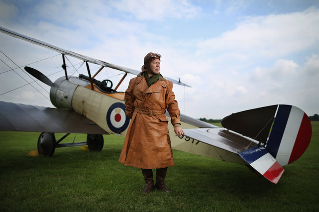 """Shuttleworth Collection Pilot Rob Millinship, poses next to a Sopwith Pup during a photocall at """"The Shuttlesworth Collection"""" on July 21, 2014 in Biggleswade, England. Of the 55,000 planes that were manufactured by the Royal Army Corps (RAC) during WWI, only around 20 remain in airworthy condition. (Photo by Dan Kitwood/Getty Images)"""