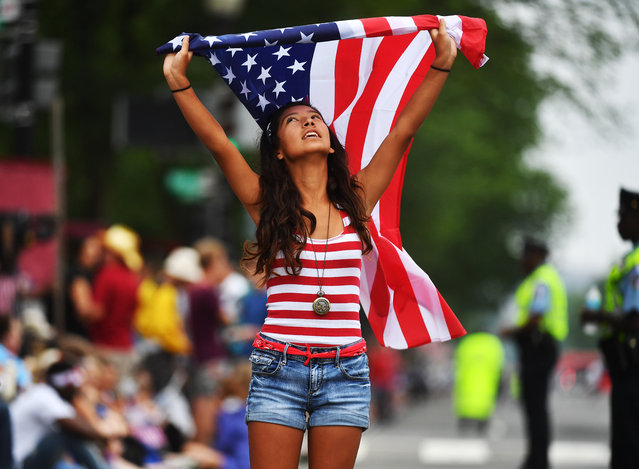 Jackie Pinos, 15, of Boynton Beach, Florida joins hundreds of people attending  the festivities for Independence Day along constitution avenue in Washington , D.C. on July 4, 2016  (Photo by Marvin Joseph/The Washington Post)