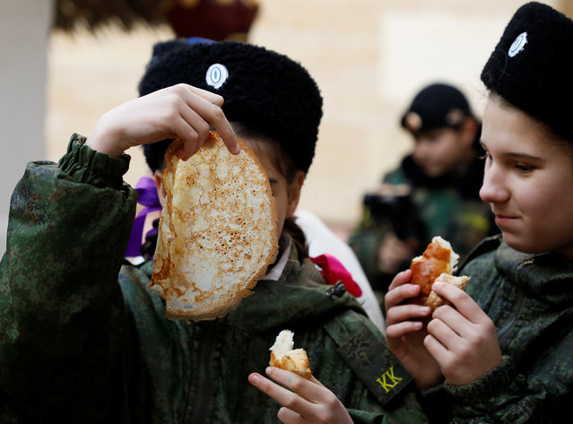 Students of the General Yermolov Cadet School eat pancakes during celebrations of Maslenitsa, or Pancake Week, a pagan holiday marking the end of winter, in the southern city of Stavropol, Russia on February 29, 2020. (Photo by Eduard Korniyenko/Reuters)