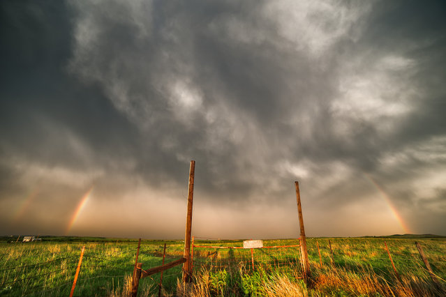 Double rainbow forms over a field in central Kansas following a line of severe storms. (Photo by Mike Hollingshead)