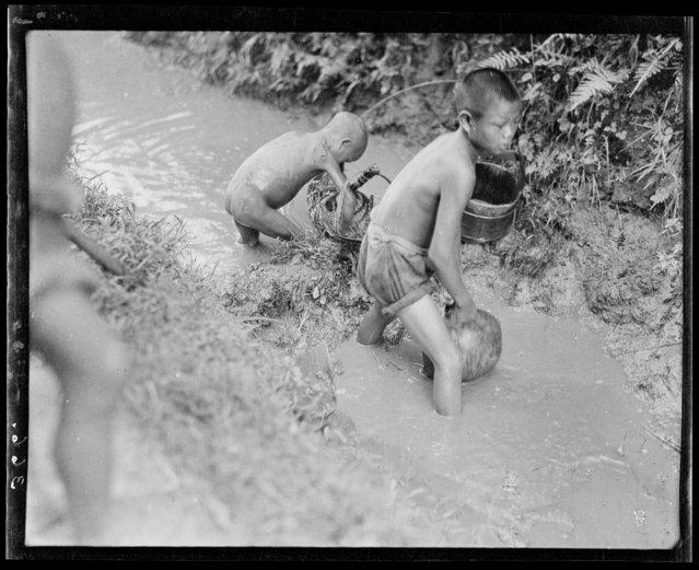 Boys Fishing. China, Xindu Xian, 1917-1919. (Photo by Sidney David Gamble)