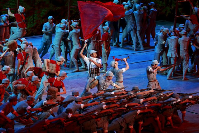 Actors dressed as Red Army soldiers perform at a gala show to mark the 70th anniversary of the end of World War Two, in Beijing, China, September 3, 2015. (Photo by Kim Kyung-Hoon/Reuters)