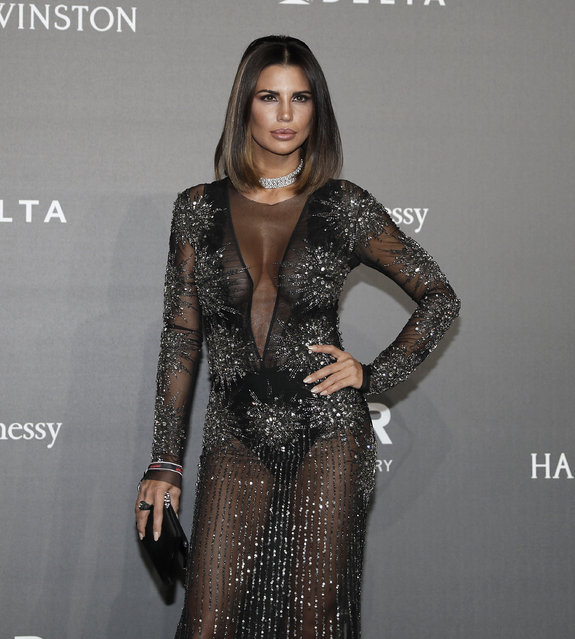Claudia Galanti poses for photographers as she arrives for the amfAR charity dinner during the fashion week in Milan, Italy, Thursday, September 21, 2017. (Photo by Antonio Calanni/AP Photo)