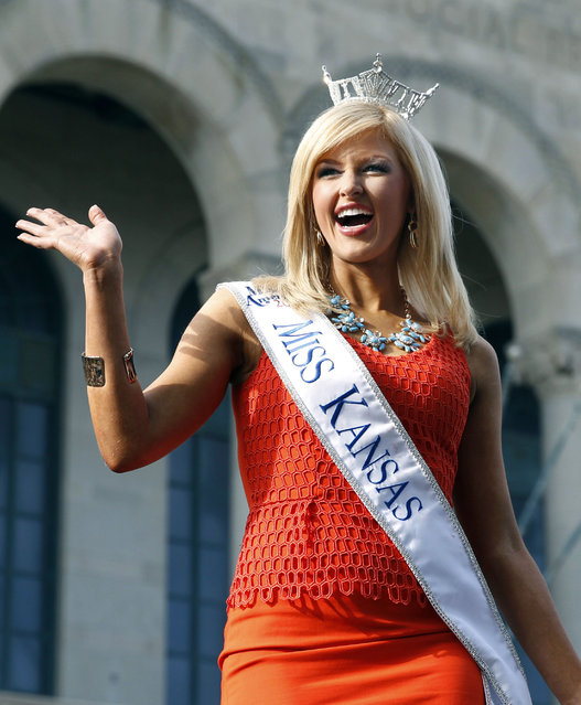 In this September 3, 2014 photo, Miss Kansas Amanda Sasek acknowledges the crowd during the Miss America Pageant arrival ceremonies in Atlantic City, N.J. Representing Kansas in the Miss America pageant, Sasek is one of several contestants whose real-life family tragedies have determined the public service platform they choose for the competition. (Photo by Mel Evans/AP Photo)